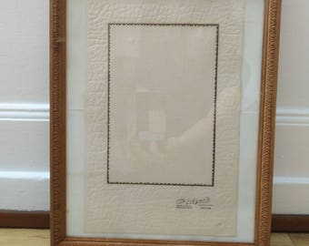 Vintage wooden background with picture frame and redone with new hooks