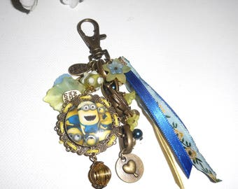 Jewelry bag/key characters humor with ribbons and blue and yellow glass beads