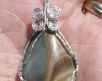 Scenic Jasper, Cabachon wirewrapped Pendant in silver filled wire.