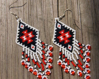 Native American style handmade beaded earrings in a native design