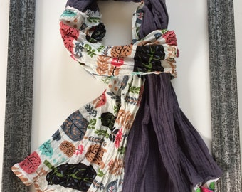 Women scarf and printed with PomPoms.