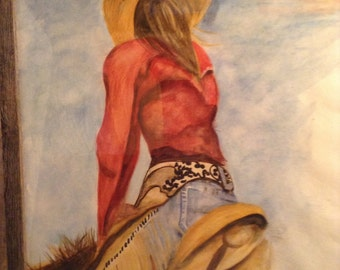 Watercolor original painting of a Cowgirl  on her horse. Painting is framed with barn like wood.
