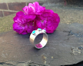 British handmade hammered silver ring with three turquoise stones.