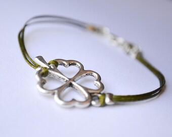 Clover cord Bracelet - cord bracelet with a silver tone four leaf clover charm - green wax string. shamrock bracelet , st. patrick's day