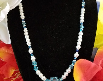 White pearls and dreamy blue crystals.  This light weight necklace is easy to match your outfit.