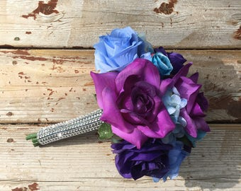 Purple rose and blue hydrangea bouquet with matching boutonnière