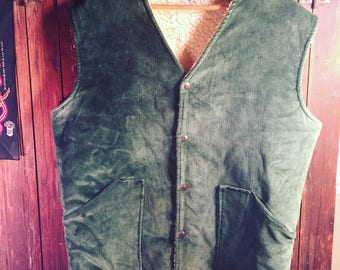 """1970s Levis Corduroy Dark Green Vest with Shearling lining tagged as a 40 but measures 25""""from pit to pit"""