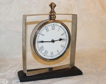 silver grandfather-style mantle clock