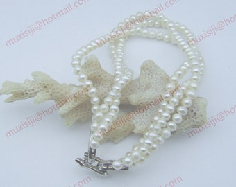 Genuine AAA white round south sea pearl three layers of bracelet