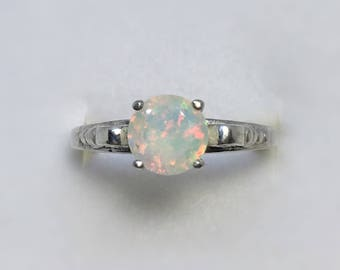 Ethiopian Opal Ring, .76 Carats, 7mm Round, Sterling Silver, Size 7