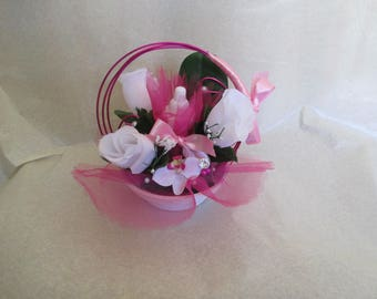 round with containing sweets, pink and white table centerpiece