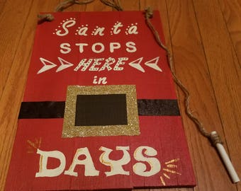 Hand crafted and painted Santa Stops Here In
