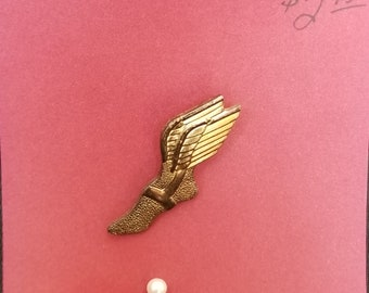 Lapel pin- shoe with wings Goodyear tire