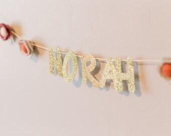 custom gold glitter name banner with felt flowers
