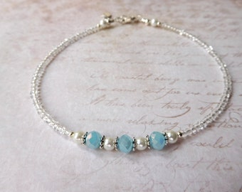 Something Blue Crystal and Pearl Bridal Anklet is that perfect little something blue with pearls and  soft blue crystals.  Adjustable.