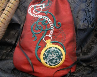 Embroidered pouch with taffeta pocket watch motif