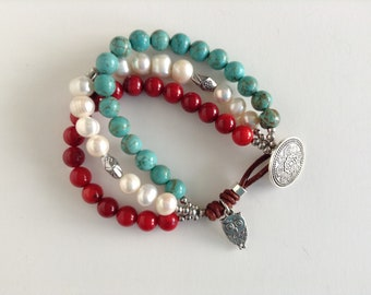 Beautiful Multi Strand Bracelet, a strand of freshwater potato pearls, natural turquoise and natural red coral beads bracelet. Elegant Gift.