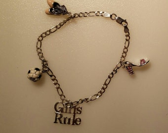 925 Silver Charm Bracelet with 4 .925 Charms.