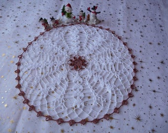 Handmade crochet lace doily in white cotton and copper.