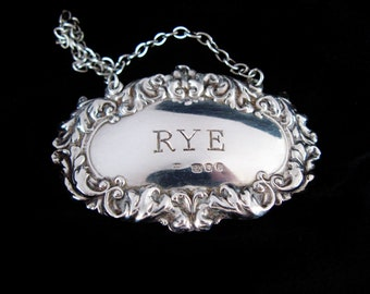 RYE Liquor Label Bottle Tag Chased Repousse Scrolling Leaf Sterling Silver English Hallmark For London 1989 R&K Richards And Knight