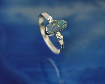 Boulder Opal Ring from Queensland Australia. Set in 14k Gold with 2 Diamonds