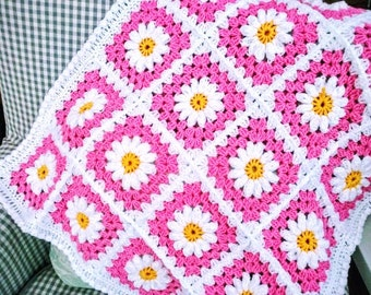 Baby blanket Crocheted in a Daisy square design in colours shades of Pink and white.