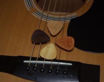 Four Wooden Guitar Picks