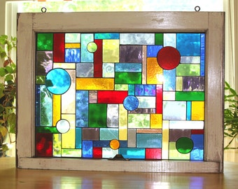 Glass on glass mosaic in vintage window