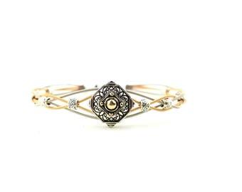 Two tone medallion guitar string bracelet