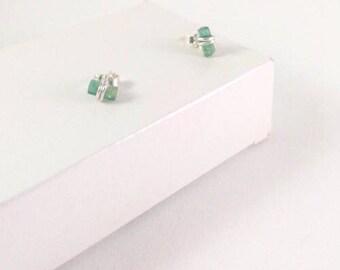 Silver earstuds with darkgreen tourmaline