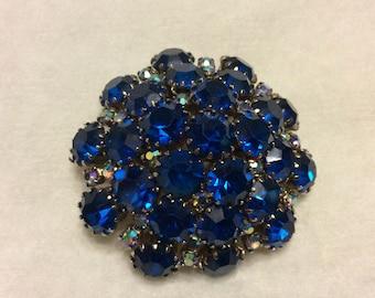 Deep blue domed rhinesotne brooch pin. 1950s