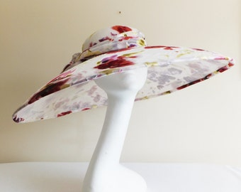 Large brimmed floral sinamay and chiffon hat