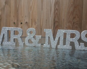 Mr & Mrs free standing wooden carving