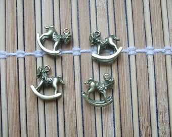 4 metal rocking horse charms bronze