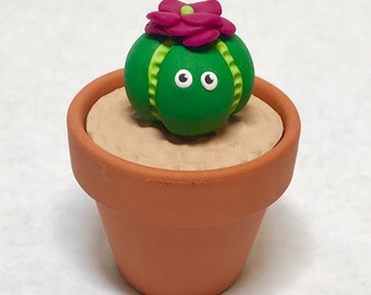 Little cacti-monster with flower on its head for your desk to bring you smiles