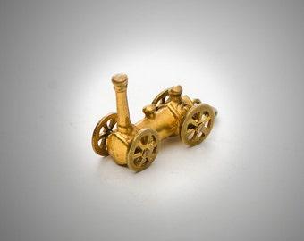 antique steam train charm w/moveable wheels gilt brass