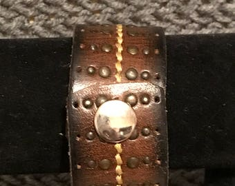 Recycled studded belt bracelet .