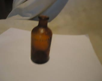 Vintage Brown Glass Bottle 60 Mils, collectable