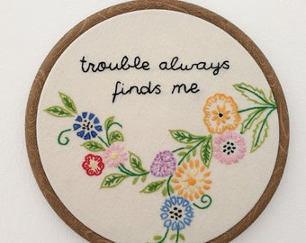 Hand embroidered and vintage hoop art - trouble always finds me quote