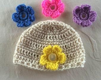 Crocheted girls baby hat with 4 detachable flowers.  Acrylic yarn