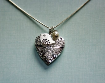Silver heart Essential oil diffuser necklace with Bird & pearl charms