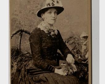 antique Carte De Visite photograph of a young lady with flowers and plants - circa 1870s - London portrait rooms Dunedin New Zealand