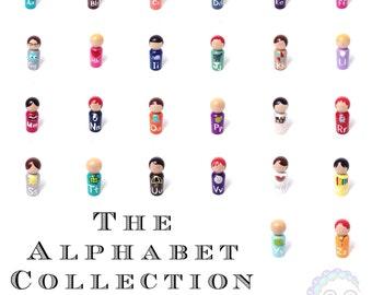 alphabet dolls, the classic collection: complete alphabet peg doll set