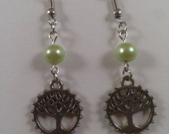 Silver tree of life earrings with green accents.