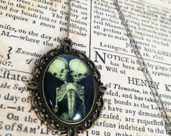 Conjoined twins pendant necklace