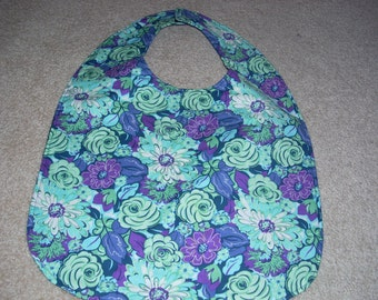 Aqua and purple flowers on navy Adult Size Bib / Clothing Protector - Reversible