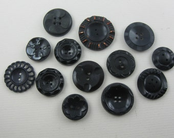 Vintage buttons convoluted. 14 ancient plastic buttons: black with decor. Approx. 1.8 to 3.3 cm in diameter. Hole buttons. VINTAGE