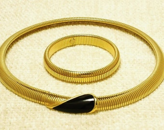 Vintage MONET RIBBED NECKLACE and Bracelet Set, Looks Like New.  Clasp in Front. Necklace Approx. 18 inches long.  Bracelet Approx 6 inches.