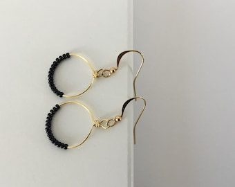 Seeded drop hoop earrings