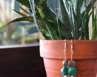 Turquoise with silver charm & moonstone.